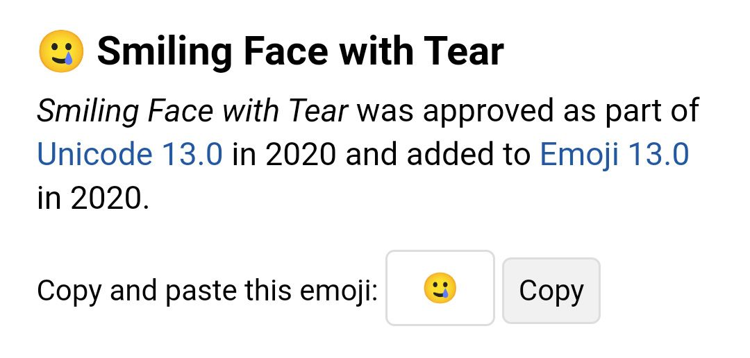 Emojipedia-Android-R-Beta-Smiling-Face-With-Tear